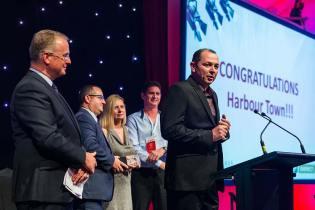 An awards winner speaker at podium during Bridgestone Tyres Conference