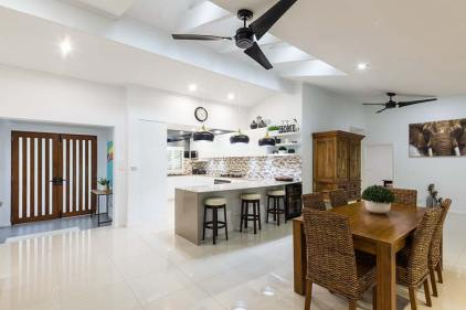 Interior of residential home including dining and kitchen areas