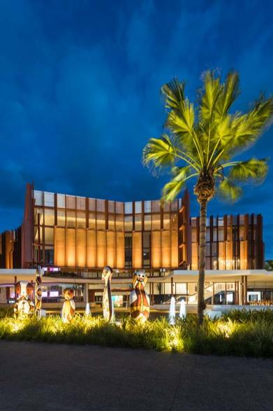 Exterior view of the Cairns Performing Arts Centre indigenous scultpures and facade at twilight