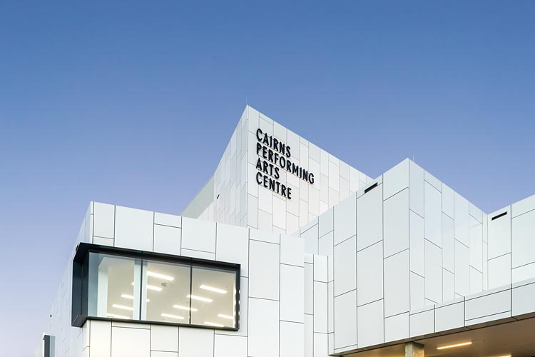 Exterior view of the Cairns Performing Arts Centre rear facade and flytower at twilight