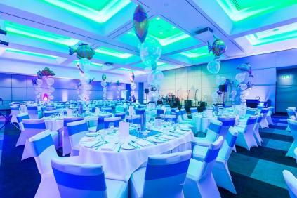 Room setup for conference dinner at Hilton Cairns