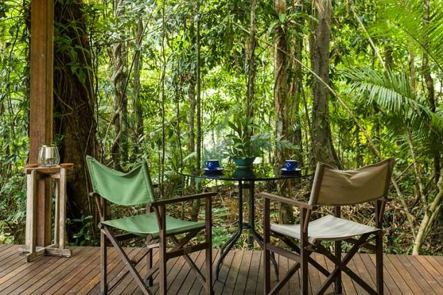 Table setting with view out to rainforest surrounds at Daintree holiday cottage