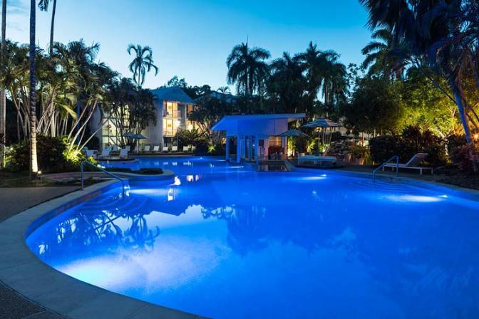 Resort pool lit at twilight, Port Douglas