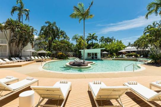 Sun lounges around a lagoon style pool at a Port Douglas resort