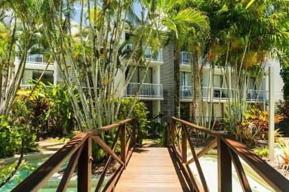 View across footbridge to resort accommodation