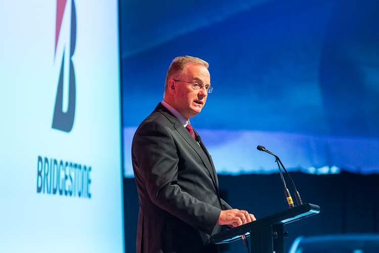 Andrew Moffatt speaking at podium during Bridgestone Conference