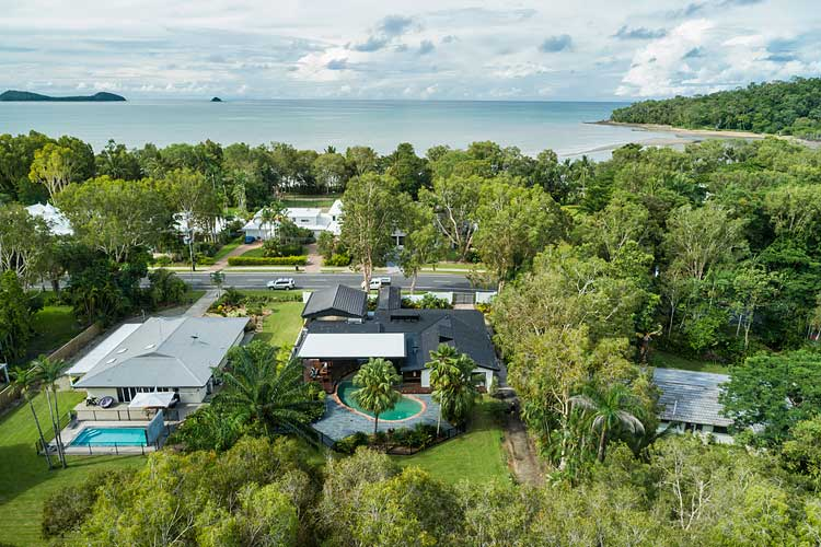 Aerial view of residential home and nearby Kewarra Beach