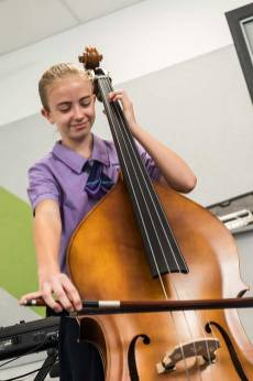 Female school student playing the cello