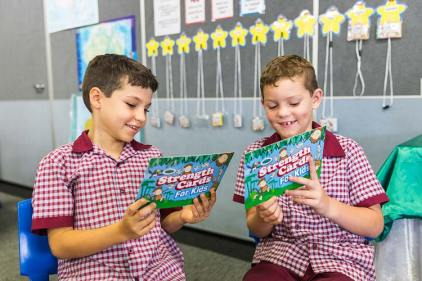 Two students playing with educational cards in the classroom