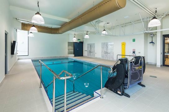 An indoor hydro pool with disability access lift