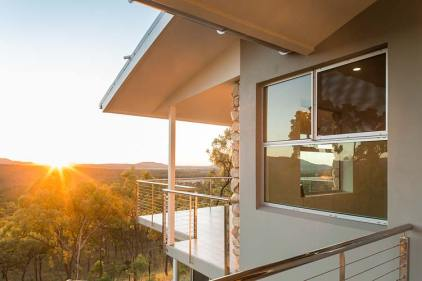 Exterior of the Walsh River House showing sunrise views over the surrounding bushland