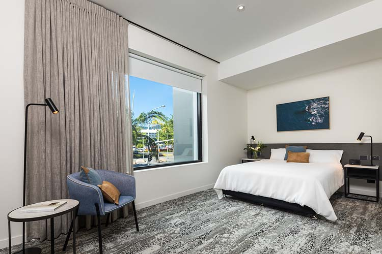 The interior of a deluxe hotel room with bed and coffee table