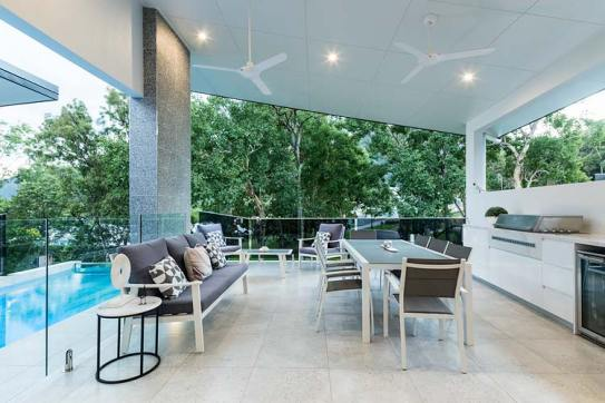 Outdoor entertaining area of residential home with green views