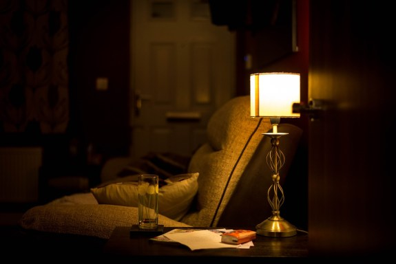 Arm chair with low lighting for reading before sleeping