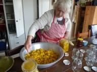 Bottling the spicy lemon pickle.