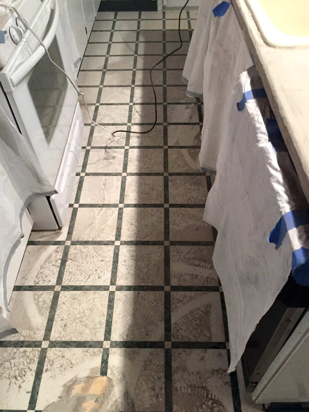 feather finish concrete over tile
