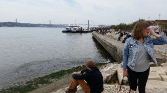 Enjoying the view at the shores of the Tagus river. At least one of us is paying attention to the view.