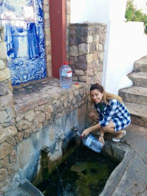 Getting water at the spring in Alte
