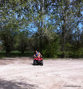 Chad and Zoë riding the 4-wheeler at his parents house in Lake County. They did this almost all day!