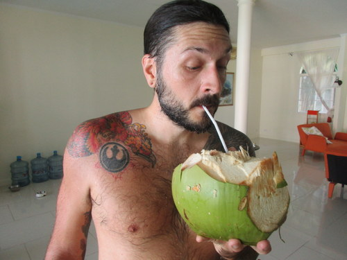 Chad drinking a coconut from the tree in our yard after going swimming. This life we lead is pretty awesome!