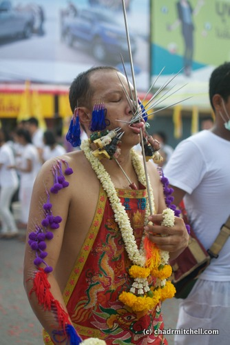 This gentleman was impressively pierced. Our friend explained that the skewers with the soldier heads are the most heavy spiritually, so the fact that this man has many of them means that he must be very pure.