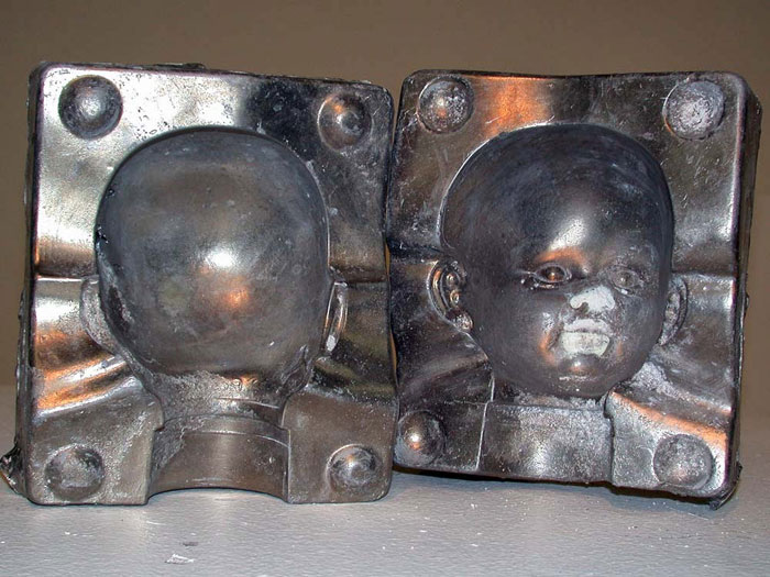 Baby Head Mold: Cast aluminum. There were some shrinkage issues, but I think those can be repaired. After a quick evaluation next week, I may recast them with thinner walls so there is less/no shrinkage around the neck. The mold matched very well, so the goal of the casting was achieved.