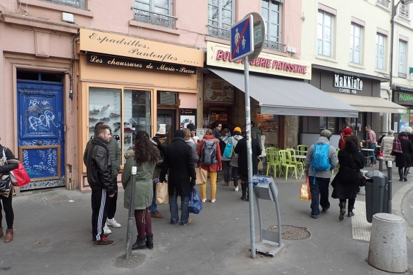 Queueing at the butcher, Sunday morning.