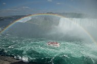 Tour boat with a rainbow