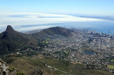 Cape Town & ships at anchor in foggy Table Bay from atop Table Mountain