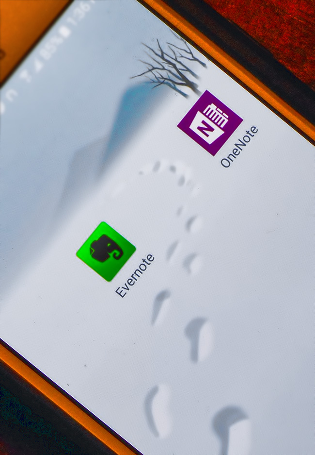 OneNote and Evernote Logos on phone