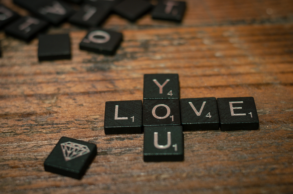 Scrabble pieces spell out love notes