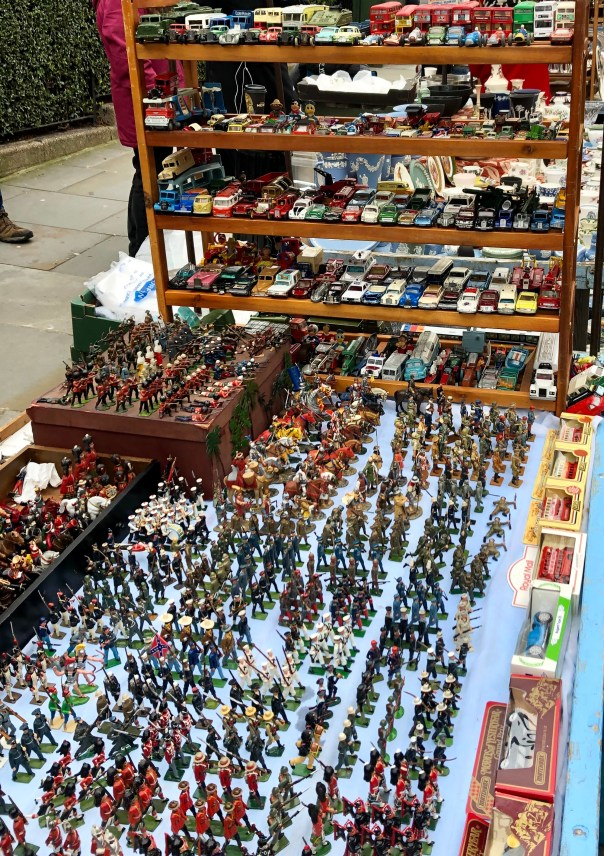 Lad toy soldiers and diecasts in Portobello road market, London, England.