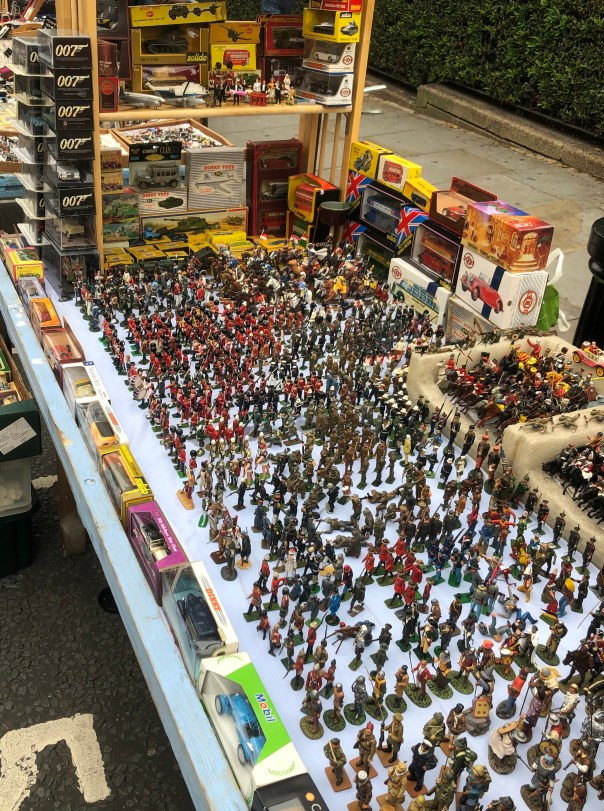 Lead soldiers/ figures and Diecast cars at stall 5, Portobello Road, London on 15th October 2020.