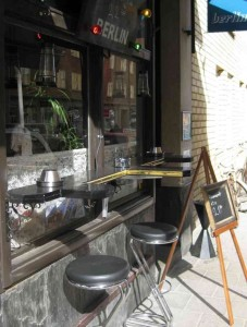 Here's an outdoor smoking area in Stockholm. It seems like a good solution: places to sit, ashtrays and heating (not visible). Photo of Berlin Bar in Stockholm.