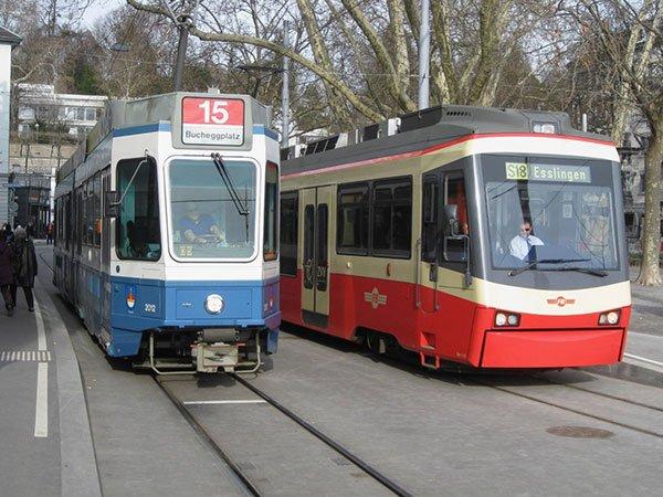 Photo of city and regional trams in Zurich's Stadelhofen Platz.