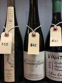 Photo of wine bottles with price tags