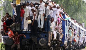 People travel in an overcrowded passenger train