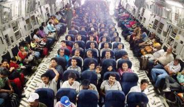 People evacuated from Yemen seated in an IAF C-17 Globemaster-III at Djibouti on April 3, 2015.