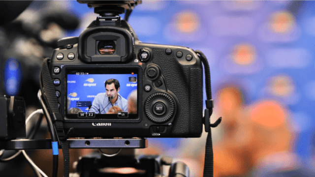 Andy Taylor Announcer. 2018 US Open. Caught on camera, Roger Federer answering questions during Media Day