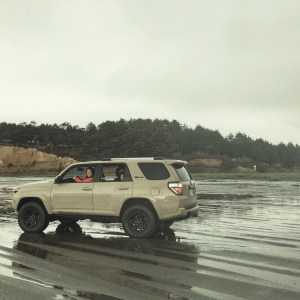 Driving on the beach in rain in a 4runner
