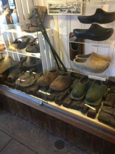 Wooden shoes factory in Zaanse Schans near Amsterdam with kids