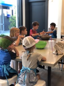 kids' cooking class at Froglegs Culinary Academy at Uvillage in Seattle, a great place for families to shop with lots of places for kids