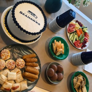 pictures of a football party with an officially licensed NFL cake with Seahawks Logo in Seattle