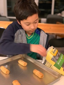 kids helping to make dinner with Ling Ling mini vegetable spring rolls
