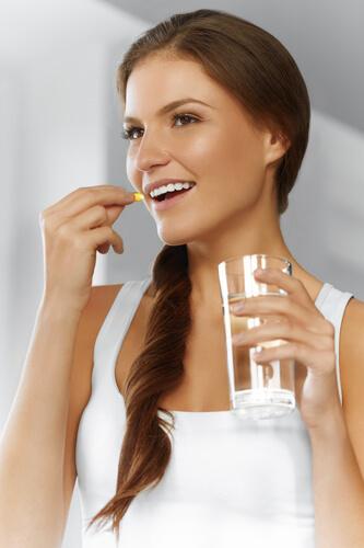 Woman Taking Best Iron Supplement Liposomal Iron