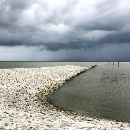 Thunderstorm clouds build over Spiekeroog, the island across Neuharlingersiel, Germany