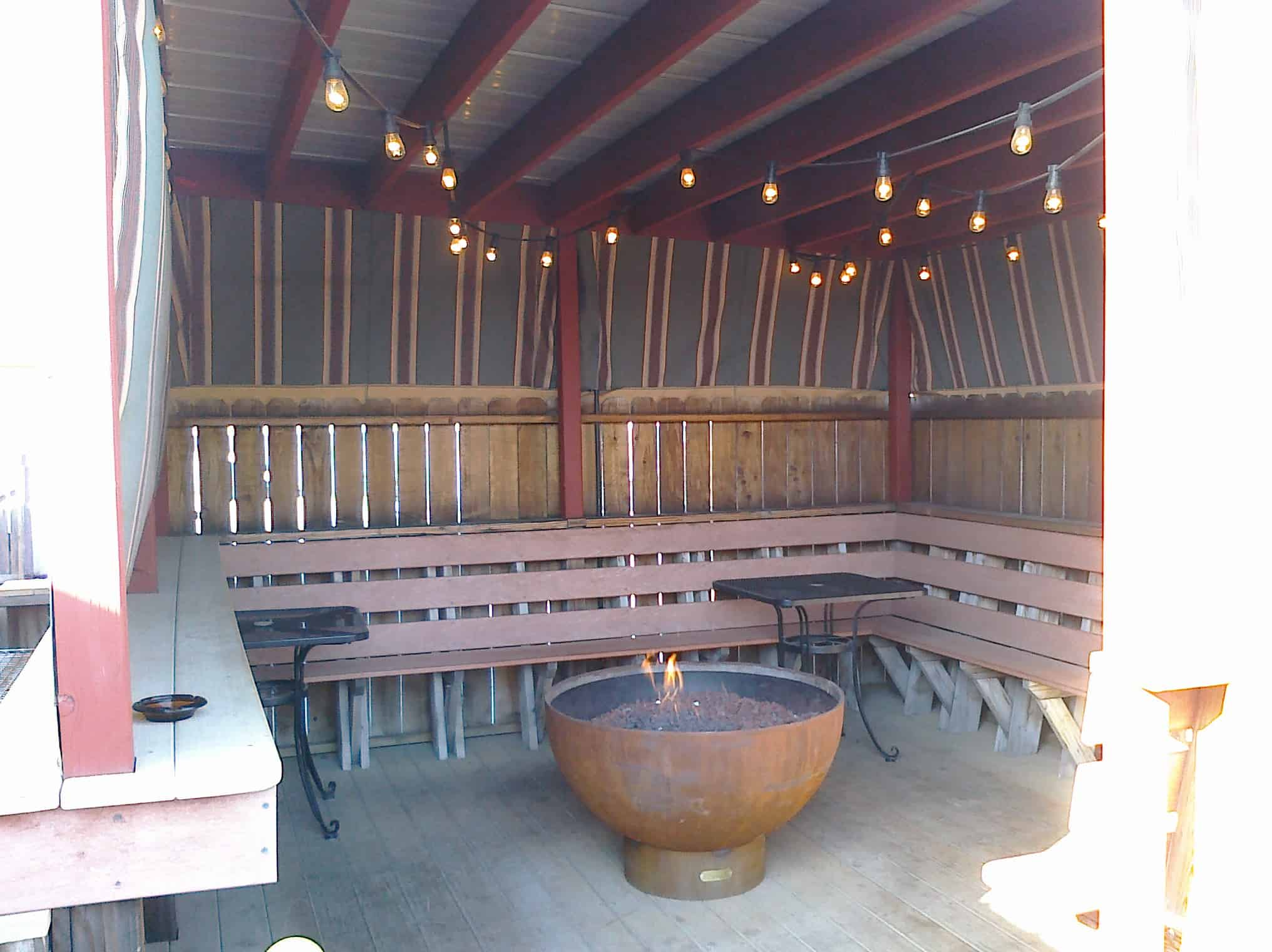 covered patio with a fire pit things