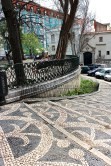 The black-and-while cobblestoned sidewalks are called calçada