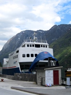 The ferry's prow opens up to let cars on the boat.