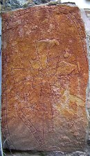 Note the runic banner that runs around the perimeter of the stone and ends in the Dragon's head. The god Odin was said to have sacrificed one of his eyes in return for learning how to read and use the magical runes.